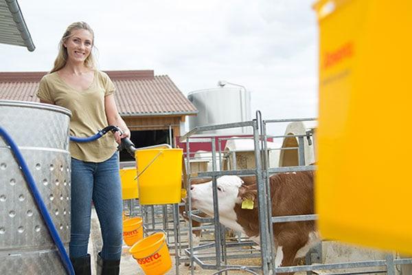 JOSERA woman while feeding calves