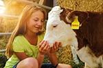 JOSERA girl with a calf